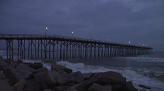 Pier and waves at dusk, 12fps Stock Footage