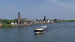 Skyline Emmerich, Germany + ship tanker sails downstream Stock Footage