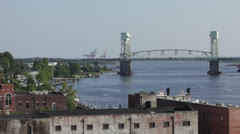 River bridge with traffic and downtown waterfront Stock Footage