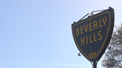 Beverly Hills sign with tree in sunlight, Hollywood, Los Angeles, LA, California Stock Footage