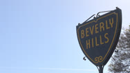 Stock Video Footage of Beverly Hills sign with tree in sunlight, Hollywood, Los Angeles, LA, California