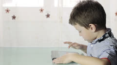 Beautiful child surf the internet with your tablet Stock Footage