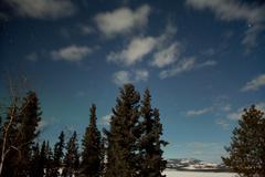 moon light faint aurora borealis northern lights - stock photo