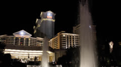 Illuminated Water Fountain Ceasars Palace Hotel Casino Las Vegas Strip by night Stock Footage