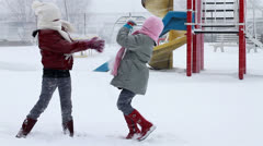 Girls fight with snow Stock Footage
