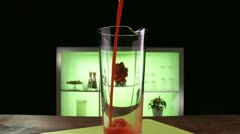 Tomato juice being poured into a glass Stock Footage