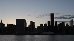 NYC Manhattan Silhouette skyline at Sunset, Skyscrapers, East River, New York Stock Footage