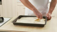 Sponge cake dough being spread in a baking tray Stock Footage