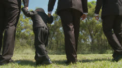 Male Wedding group walk from camera - dolly shot Stock Footage