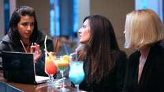 Girls drinking cocktais Stock Footage