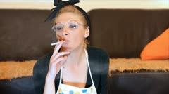 Housewife on break smoking cigarette Stock Footage