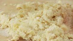 Dough ingredients being mixed with a scraper Stock Footage