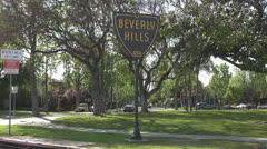 Beverly Hills sign with traffic street by day, Hollywood, Los Angeles, LA, USA - stock footage