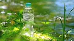 Pet bottle of pure drink in forest.+sound Stock Footage