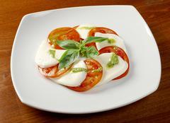 arrangement of mozzarella and tomatoes - stock photo