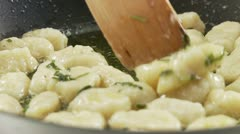 Gnocci and sage butter in a pan Stock Footage