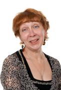portrait of a smiling middle-aged woman - stock photo