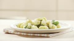 Gnocci with sage butter being arranged Stock Footage