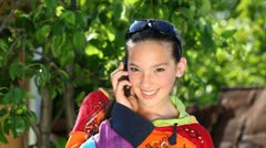 Beautiful girl talking over a phone Stock Footage