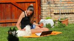 Teenage girl and maltese dog Stock Footage