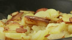 Fried potatoes in a pan Stock Footage