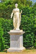 statue of athena in the gardens of versailles, france - stock photo