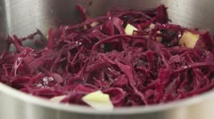 Red cabbage with apples being braised Stock Footage