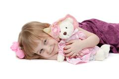 a little girl 4 years old with a plush toy bear - stock photo