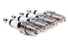 four new spark plugs - stock photo