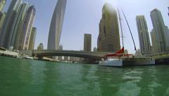 Dubai Marina Entrance and Catamaran HD Stock Footage