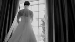 B&W Back of Bride looking out of window Stock Footage
