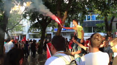 Protester holds flare and cheers during the Gezipark protest Stock Footage