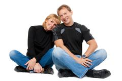 beautiful couple in love sitting in the lotus position - stock photo