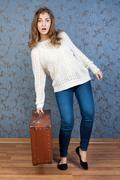 girl with an old brown suitcase - stock photo