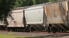 Freight train slowly moves along the track Stock Footage