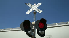 Red lights flash on railroad crossing Stock Footage