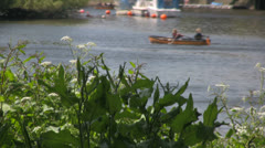 A pleasant riverbank scenic with rowing boat in the distance on the Thames river Stock Footage
