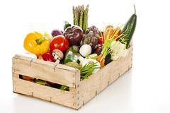 assortment of fresh vegetables in a crate - stock photo