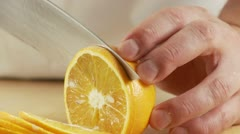 An orange being sliced Stock Footage