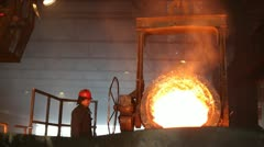 Stock Video Footage of Hard, manual work in a foundry.