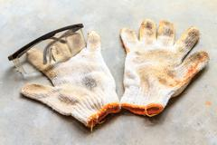 glasses on workgloves - stock photo