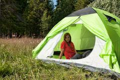 Girl in a red dress in a tent in a forest Stock Photos