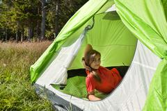 girl resting in a canvas tent - stock photo