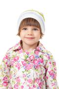 Portrait of a charming little girl in a cap Stock Photos