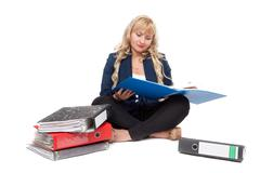 beautiful girl sitting on the floor with folders for documents - stock photo