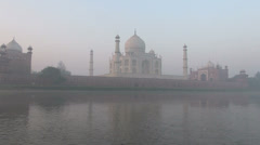 India Taj Mahal seen from river at dawn Stock Footage