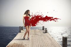 creative fashion explosion with red dress - stock photo