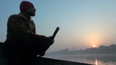 India a side view of a boatman in silhouette Stock Footage