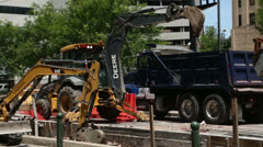 Diggers and construction workers, houston Stock Footage