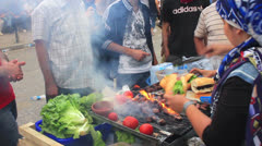 Stock Video Footage of Fire grilled meatballs for protesters